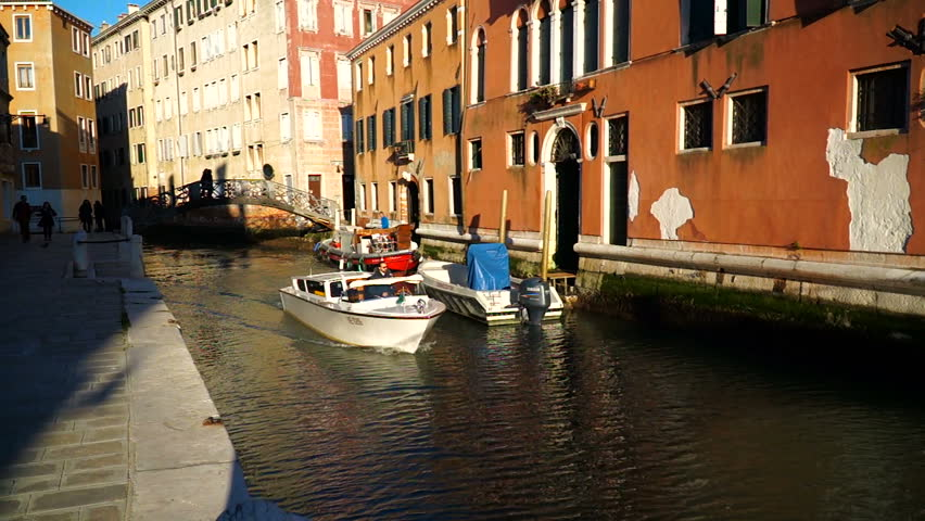 Venice, Italy - March, 3, 2017: Traditional view of Venice, boats moored near the buildings. | Shutterstock HD Video #25161251