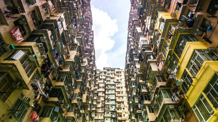 4k. Time lapse of Old Apartment with Moving Cloud in Hong Kong of China  | Shutterstock HD Video #25163555