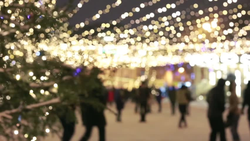 People walking on Christmas market. Christmas shopping/People silhouettes walking on the Christmas market. Strong back light from small cabins on the market.  | Shutterstock HD Video #25170575