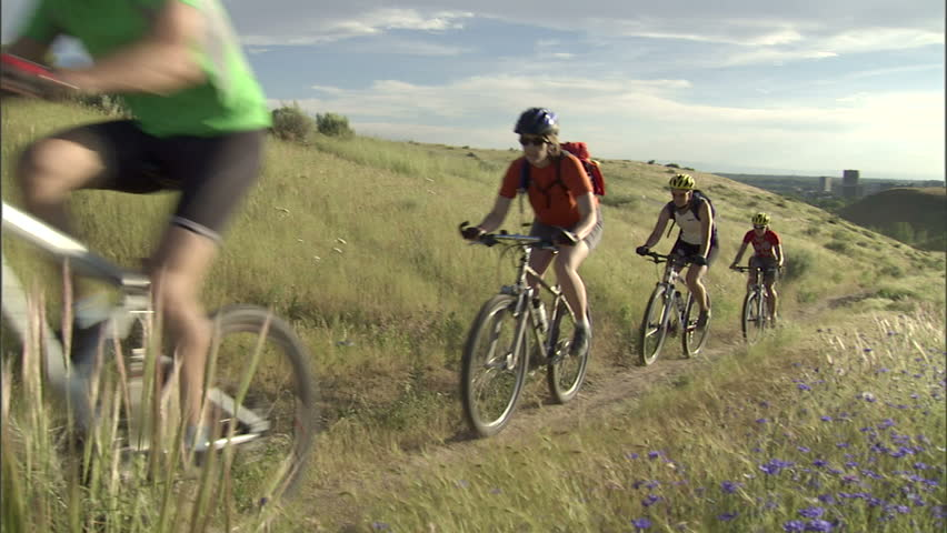 Cyclists escaping the city on a mountain bike trail