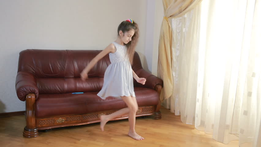 Little cute girl dancing and fooling around at home | Shutterstock HD Video #25183535
