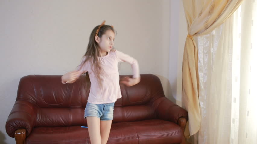 Little cute girl dancing and fooling around at home | Shutterstock HD Video #25183553