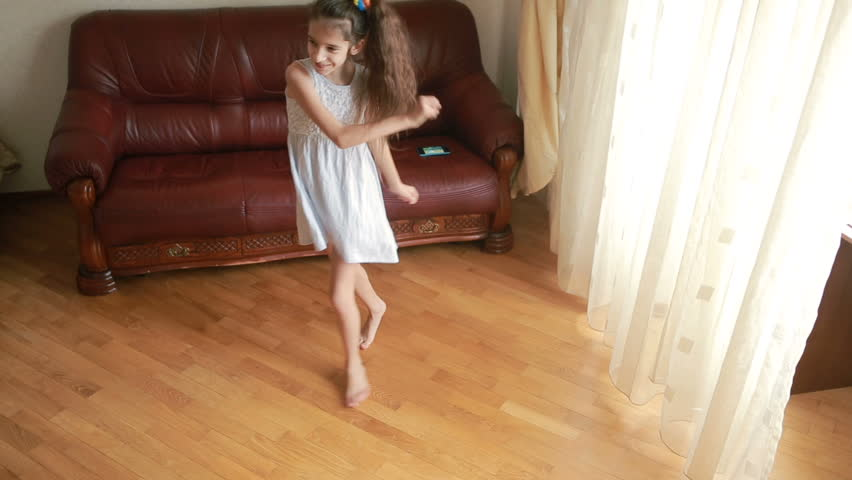 Little cute girl dancing and fooling around at home | Shutterstock HD Video #25183562