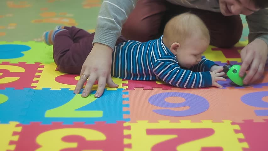 Spending Quality Time With a Baby Boy. Father and Son in Line Are Playing With Green Educational Toys. Learn Numbers With a Smart Handsome Little Gentleman Wearing Stylish Blue in Line Sweater Maroon | Shutterstock HD Video #25215989