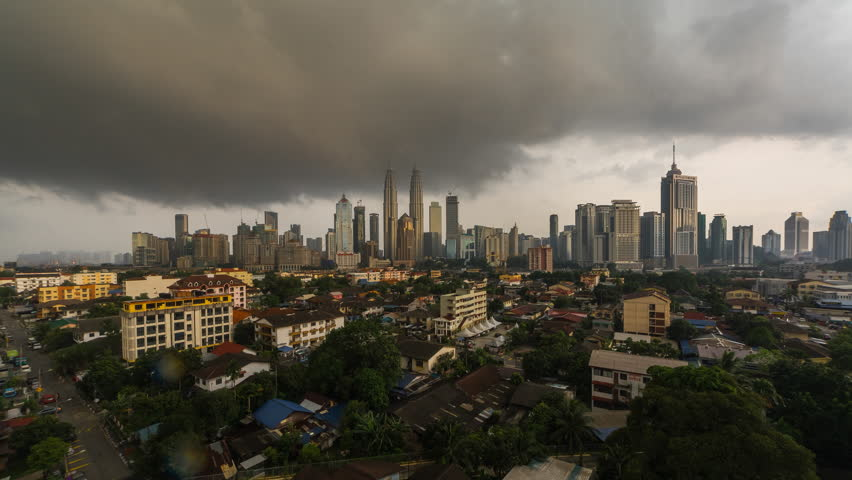 4k time lapse of dramatic weather scenery at Kuala Lumpur city. Moving and changing color clouds. Aerial view. | Shutterstock HD Video #25222037