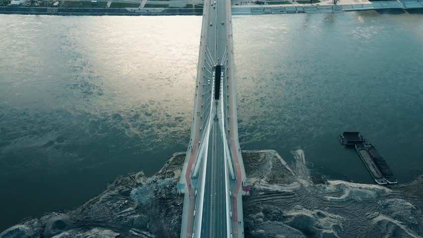 Aerial shot of Vistula river and Holy Cross cable bridge in Warsaw, Poland. 4K video | Shutterstock HD Video #25223270