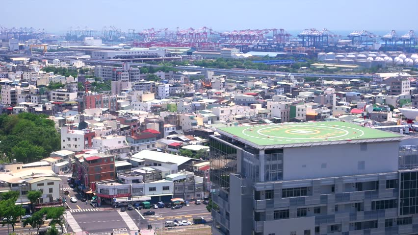 Kaohsiung - April 2016: Aerial view of industrial part of city with port cranes in background.  | Shutterstock HD Video #25231559