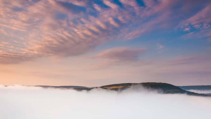 Epic aerial flight through mountain dense fog. Dramatic and gorgeous morning scene. Location place Dnister canyon, Ukraine, Europe. Time lapse clip, interval shooting in HD 1080 video. | Shutterstock HD Video #25244240