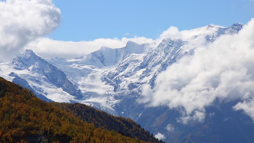 Fantastic massif in autumn season. Location place famous Mt. Ushba, Upper Svaneti Mestia, Georgia, Europe. High Caucasus ridge. Climate change. Explore the world's beauty. Shooting in HD 1080 video. | Shutterstock HD Video #25244375