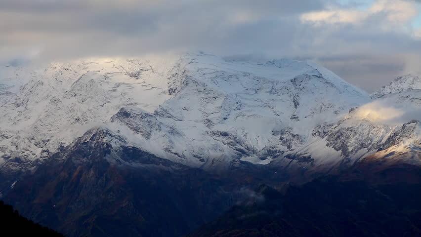 Fantastic massif in autumn season. Location place famous Mt. Ushba, Upper Svaneti Mestia, Georgia, Europe. High Caucasus ridge. Climate change. Explore the world's beauty. Shooting in HD 1080 video. | Shutterstock HD Video #25244384