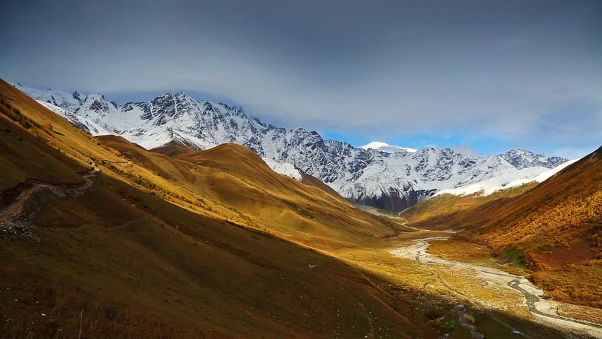 A look at the main Caucasus ridge. Picturesque day and gorgeous scene. Location place Ushguli, Svaneti, Georgia country, Europe. Explore the world's beauty. Season change. Shooting in HD 1080 video. | Shutterstock HD Video #25244393