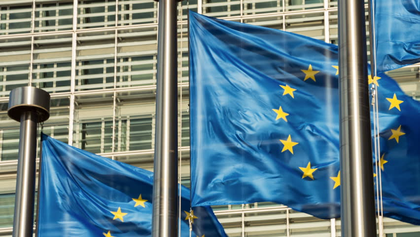 European Union flags waving in the wind in front of European Commission building. Brussels, Belgium. Full HD, 1080p | Shutterstock HD Video #25247741