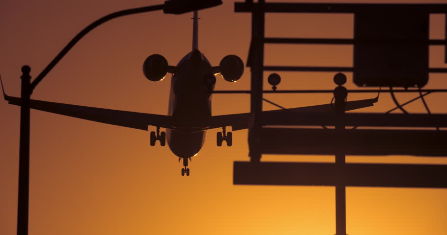 Jet coming in for a landing at LAX | Shutterstock HD Video #25296890