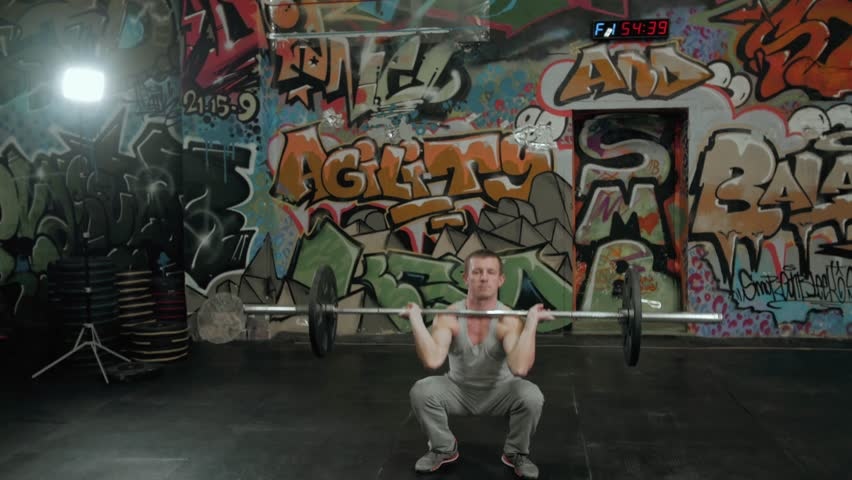 Very power athletic guy , execute exercise with dumbbells barbell, in sport hall crossfit arena | Shutterstock HD Video #25331954