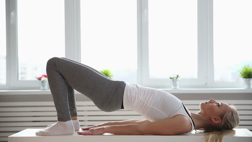 Fitness, sport, power-lifting and people concept - stretching young woman in the gym | Shutterstock HD Video #25334780