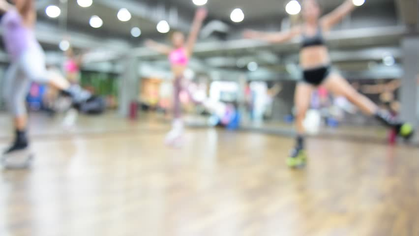 Blurred of an unidentified group of woman  doing exercises fitness with kangoo shoes.The best background for use. | Shutterstock HD Video #25335068