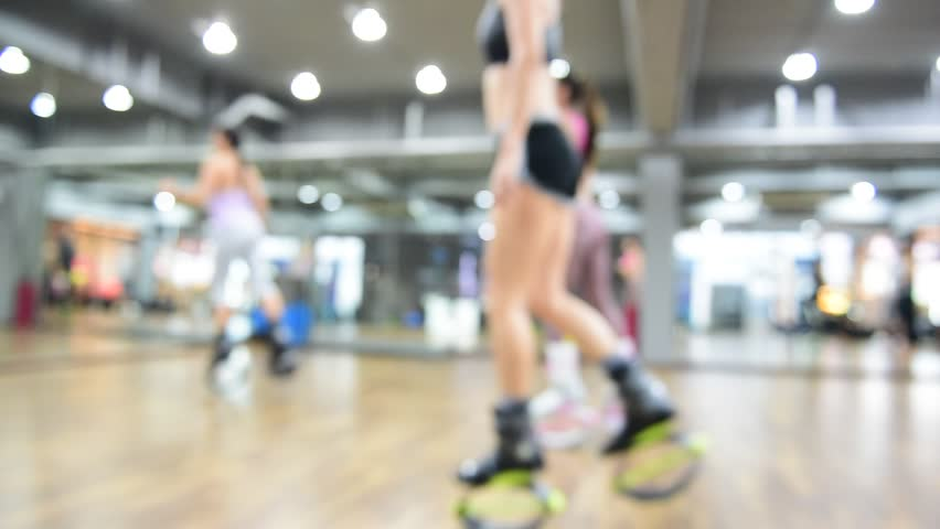 Blurred of an unidentified group of woman  doing exercises fitness with kangoo shoes.The best background for use.   Shutterstock HD Video #25335077