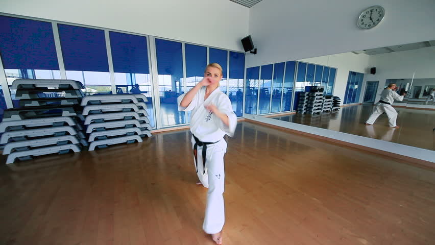Young woman practicing the karate in the sport's gym | Shutterstock HD Video #25335563