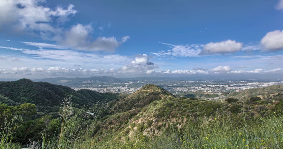 4K HDR Time-lapse of Burbank - from mountaintop overlooking City of Burbank with blue sky, billowing white clouds and Verdugo mountains.  | Shutterstock HD Video #25340594