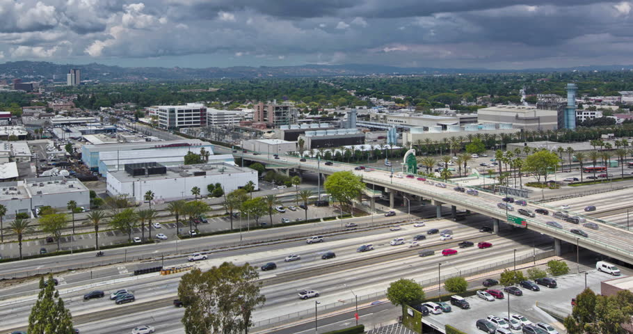 4K HDR Time-lapse of Burbank - from top of building overlooking Burbank City with the 5 Freeway running through it. Blue sky with billowing white clouds. Flowing traffic. View of San Fernando Valley. | Shutterstock HD Video #25340603