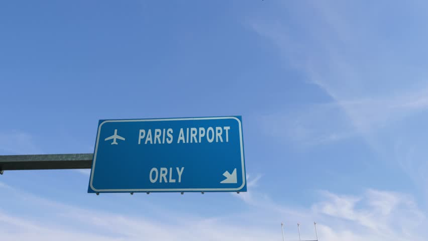 Paris orly airport sign airplane passing overhead   Shutterstock HD Video #25340639