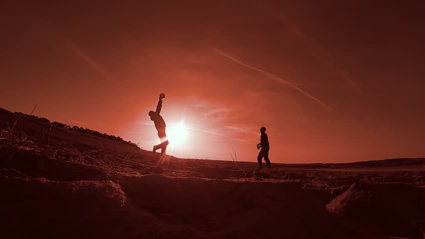 Volleyball. Two men playing volleyball silhouettes at sunset sunlight, Sport on the beach | Shutterstock HD Video #25342016