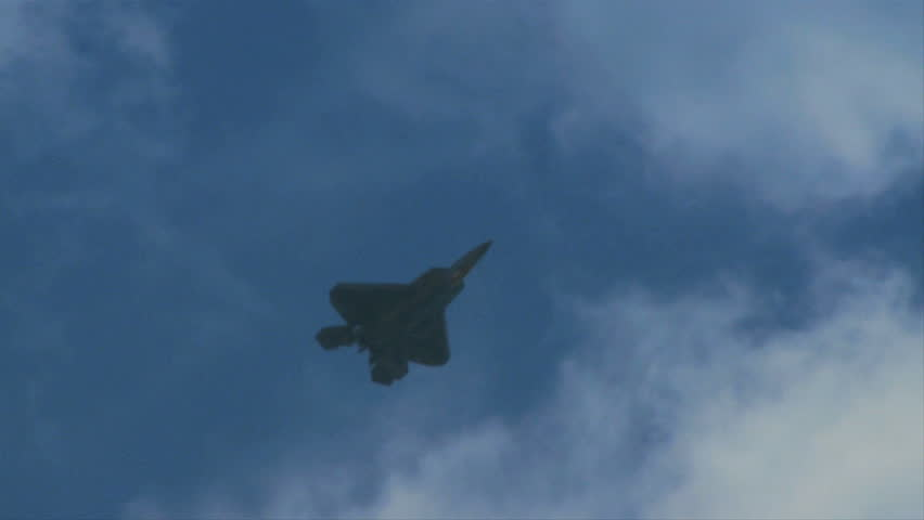 QUONSET, RHODE ISLAND - JUNE 2012: Air force F-22 Raptor doing somersault at the Rhode Island National Guard Open House and Air Show in June 2012.