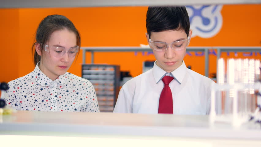 Students working on a chemistry project together in chemistry classroom at school. | Shutterstock HD Video #25344365