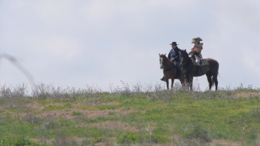 MONTANA - SUMMER 2015 - Reenactment, Recreation.  1800s US Cavalry in action, Plains Indian Wars - General Custer, commander on horse, 7th cavalry, during wild west.  Men on Horses on top of hill. | Shutterstock HD Video #25356146