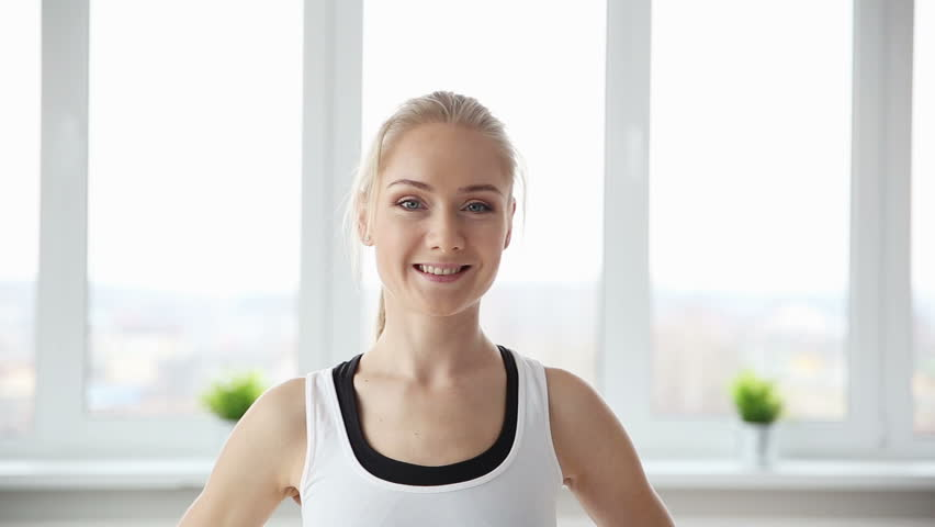 Fitness, sport, power-lifting and people concept - stretching young woman in the gym closeup | Shutterstock HD Video #25356533