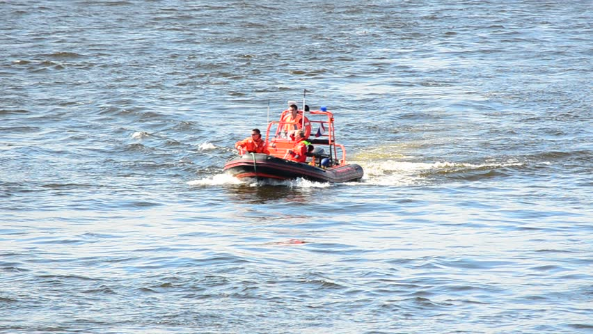 SAINT PETERSBURG, RUSSIA - July 25, 2015: unknown people in life jackets on the rescue boat floating on the river Neva | Shutterstock HD Video #25373876