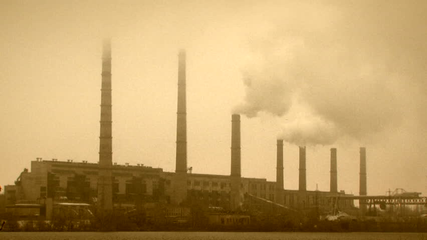 Factory pipes steam into the sky. Steaming pipes.