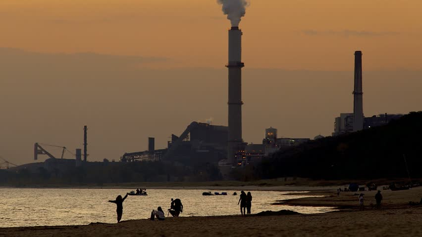 Steel mill and smoke stacks on shores of Lake Michigan - HD stock video clip