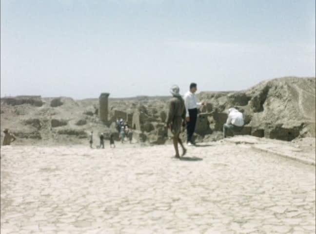BABYLON, IRAQ - JULY 1956: Iraqi workers excavating in Babylon, Iraq. Shot on 16mm film.