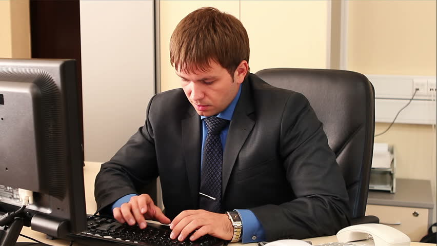 Man in the office typing in hurry. Hurry up to finish the work. Stressed up