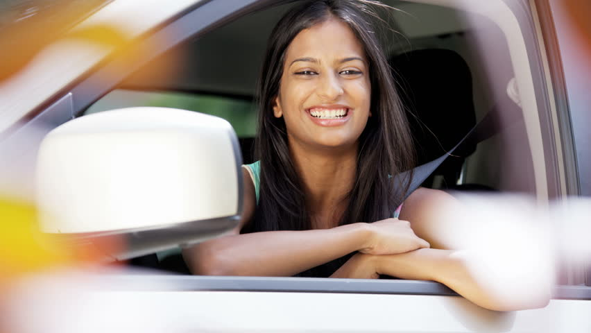 Outdoor car lifestyle Asian Indian American woman young attractive driving licence happy trip portrait RED DRAGON | Shutterstock HD Video #25652993