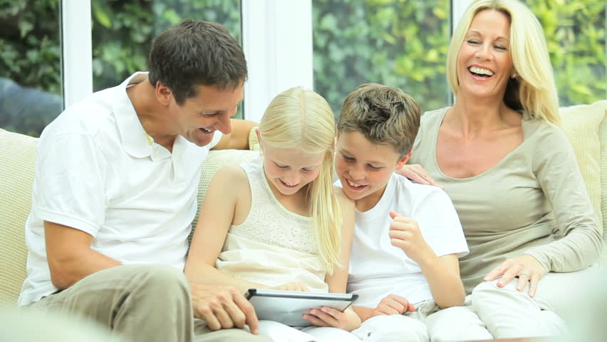 Young caucasian family using a wireless tablet for entertainment | Shutterstock HD Video #25654397