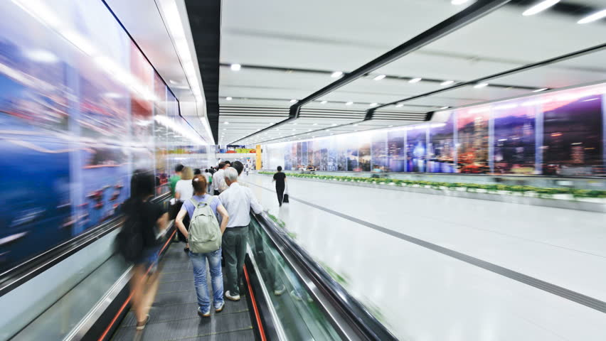 HONG KONG - CIRCA MAY 2011: Commuters on a moving walking way in Hong Kong Central MTR Station during the day - HD stock footage clip