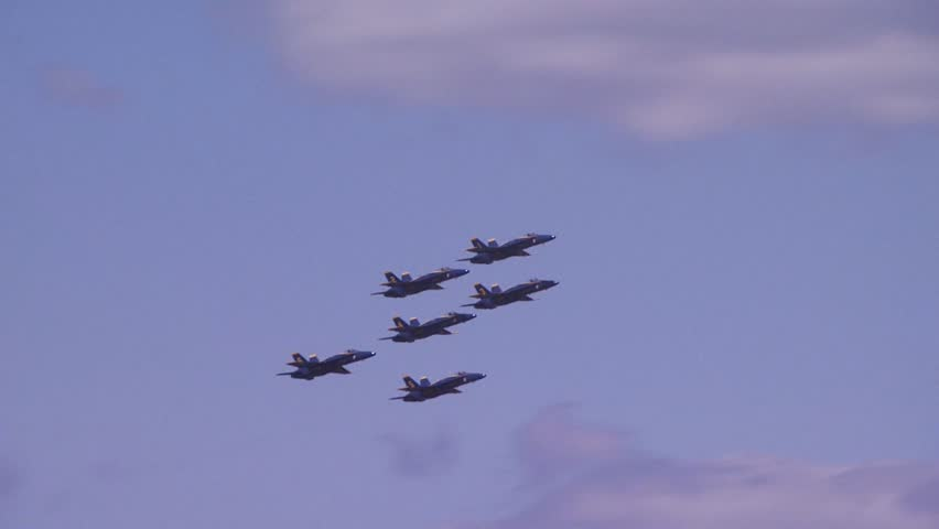 QUONSET, RHODE ISLAND - CIRCA JUNE 2012: Six Blue Angels jets flying past camera and then splitting away in different directions