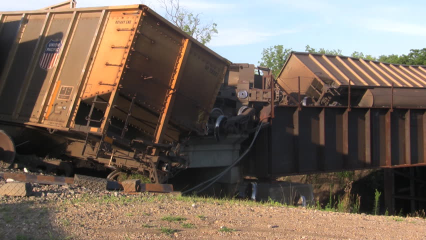 SILVERLAKE, KS - JULY 10: massive train derailment on the Soldier Creek bridge that happened around 6:00 pm spilling thousands of tons of coal into the creek. - HD stock video clip
