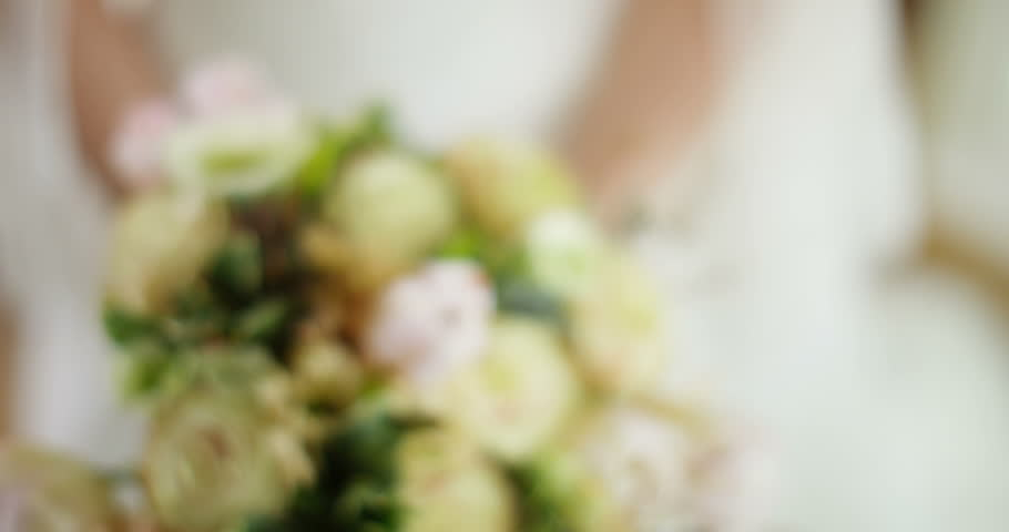 4k, Bride holding bunch of wedding flowers. | Shutterstock HD Video #25852604