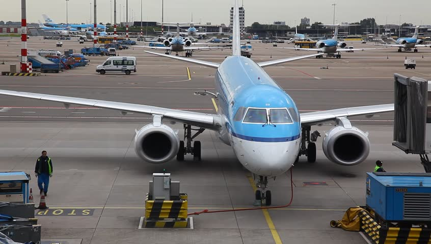 AMSTERDAM - THE NETHERLANDS - JULY 17: KLM airplanes activity in Schiphol airport near gates, Amsterdam, The Netherlands, July 17, 2012 - HD stock footage clip