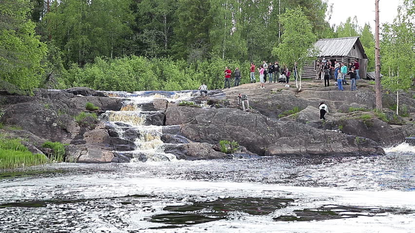 RUSKEALA, KARELIA, RUSSIA - CIRCA JUNE 2012: Tourists are in Ruskeala waterfalls - four falls flat in Sortavala region on the river Tohmajoki on circa June, 2012 in Ruskeala, Karelia, Russia - HD stock video clip