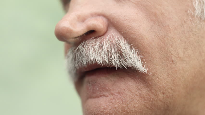 Extreme close-up of caucasian middle aged man mustache, mouth and face - HD stock footage clip