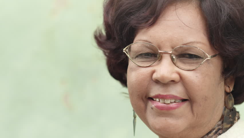 Portrait of happy old african american woman with glasses and wig smiling at camera - HD stock video clip