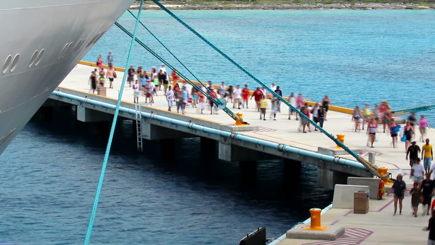 Cruise ship passengers return to their cruise ship at the pier in Cozumel,