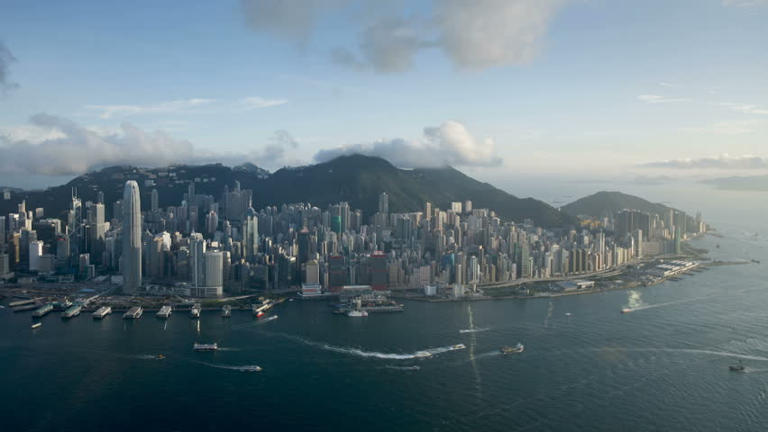 Aerial view over Hong Kong Island looking towards Victoria Peak showing the busy Victoria Harbour and Financial District of Central, Hong Kong, China | Shutterstock HD Video #2607305