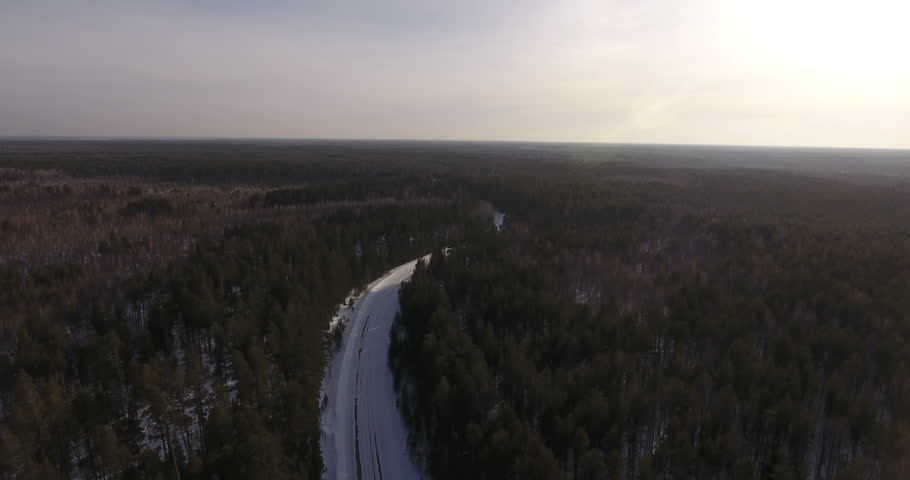 Aerial view from helicopter. Wild nature of Siberia. The concept of life's journey, pacification, inspiration. The rural road passes between a coniferous dense forest and leaves far into the distance   Shutterstock HD Video #26096792