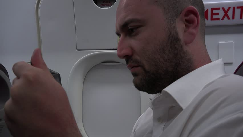 Businessman with smartphone airplane flight emergency exit seat business journey | Shutterstock HD Video #26099006