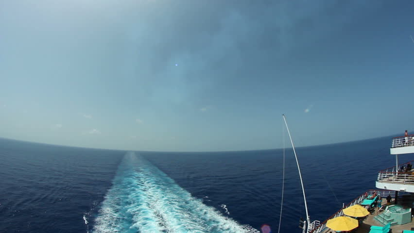 Looking off the back of a large cruise ship.